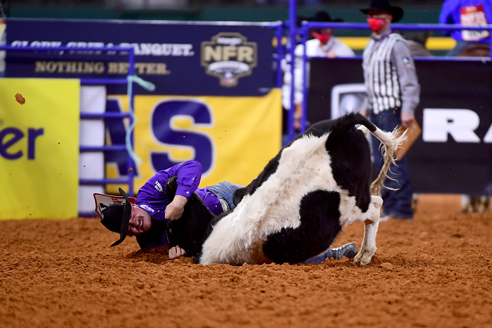 Tanner Brunner drives his steer to the ground during his 3.8-second run to place third in Wednesday's seventh round of the National Finals Rodeo. (PHOTO BY JAMES PHIFER)