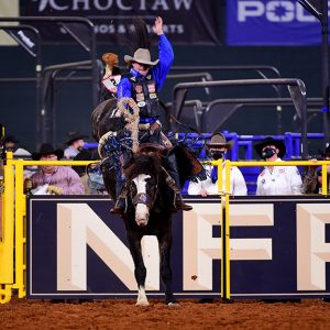 Wyatt Casper rides Andrews Rodeo's Brutus for 82.5 points to place in Thursday's eighth round of the NFR. He dropped to second in the world standings for the first time in eight months. (PHOTO BY JAMES PHIFER)