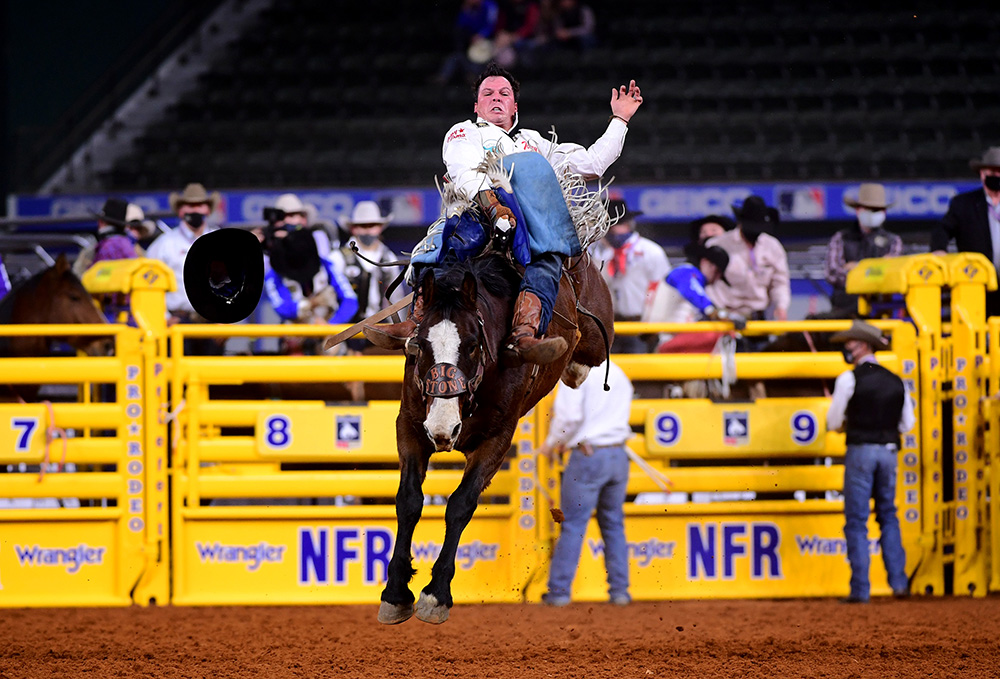 Richmond Champion rides Big Stone's Mayhem for 81.5 points to finish fifth in Wednesday's seventh round of the National Finals Rodeo. (PHOTO BY JAMES PHIFER)