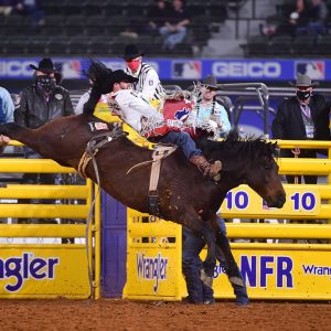 Mason Clements rides Brookman Rodeo's Famous Dex for 84 points to place out of the money in the 10th round, but he still cashed in for fifth in the National Finals Rodeo average. (PHOTO BY JAMES PHIFER)