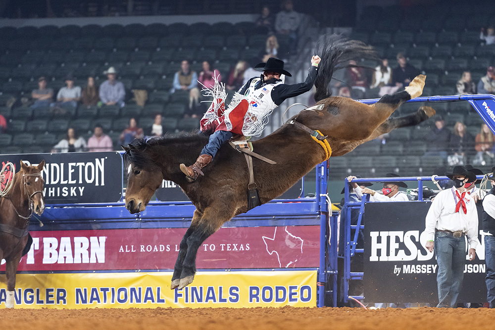 Mason Clements rides Frontier Rodeo's Show Stomper for 83 points to place in Saturday's third round of the National Finals Rodeo. (PHOTO BY JAMES PHIFER)