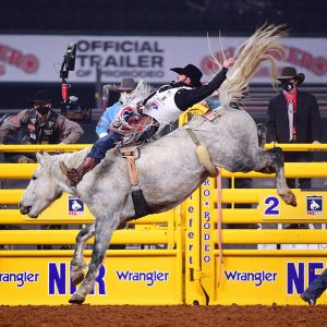 Mason Clements rides Sankey Rodeo's Mental Illness to place in Thursday's eighth round of the National Finals Rodeo. (PHOTO BY JAMES PHIFER)