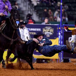 Jacob Edler of State Center, Iowa, makes his final run during a world championship performance at the National Finals Rodeo. (PHOTO BY JAMES PHIFER)