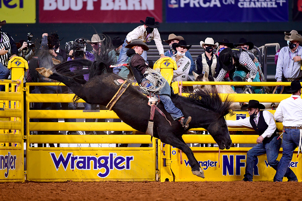 Orin Larsen rides Stace Smith Pro Rodeo's Cactus Black for 83.5 points to finish sixth in Friday's ninth round of the National Finals Rodeo. (PHOTO BY JAMES PHIFER)
