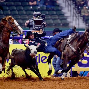 Jace Melvin stopped the clock in 3.7 seconds to place in Friday's ninth round of the National Finals Rodeo. (PHOTO BY JAMES PHIFER)