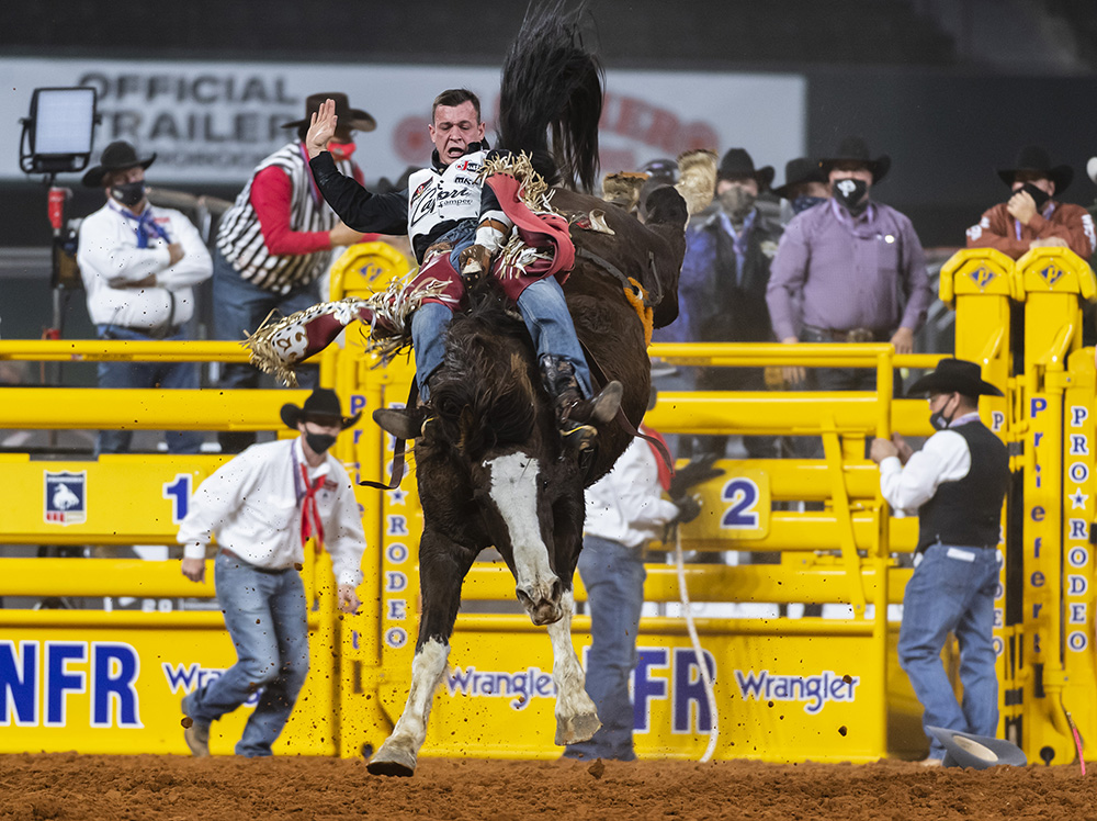 Tim O'Connell rides J Bar J's Blessed Assurance for 85.5 points to place in Tuesday's sixth round of the National Finals Rodeo. (PHOTO BY JAMES PHIFER)