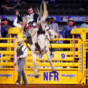 Tim O'Connell rides Powder River's Two Buck Chuck for 89 points to finish third in Saturday's 10th round of the National Finals Rodeo. (PHOTO BY JAMES PHIFER)