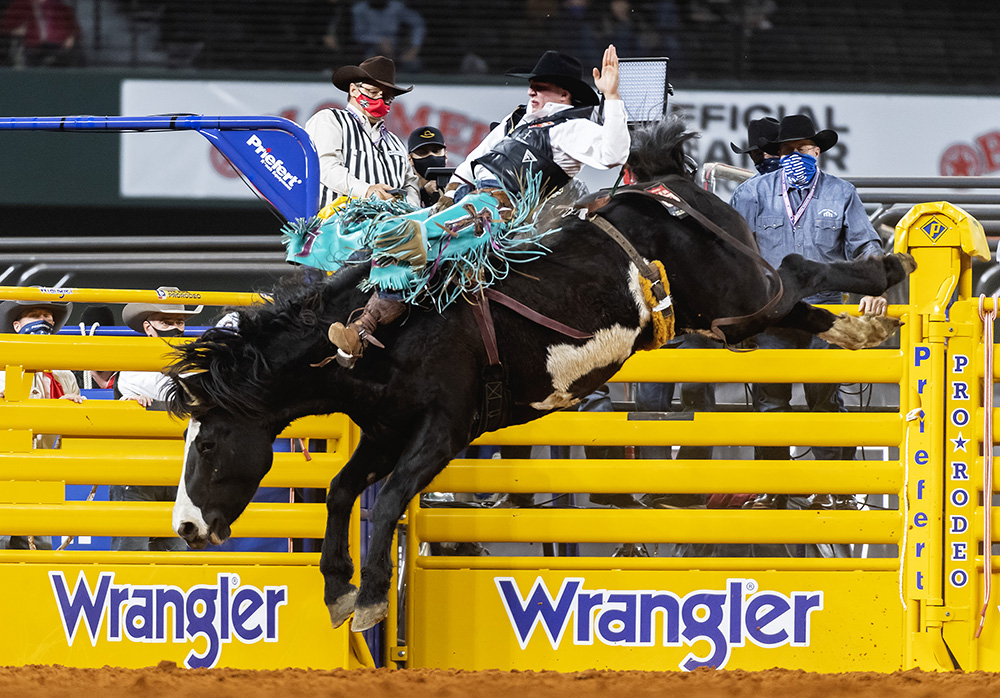 Jess Pope rides Three Hills Rodeo's Devil's Advocate for 85 points to place in Sunday's fourth go-round of the National Finals Rodeo. (PHOTO BY JAMES PHIFER)