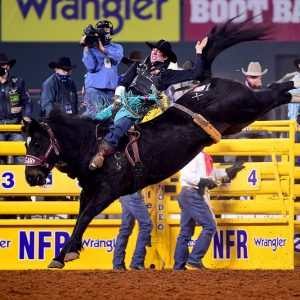 Jess Pope rides Calgary's Xplosive Skies for 89 points to win Thursday's eighth round of the National Finals Rodeo. (PHOTO BY JAMES PHIFER)