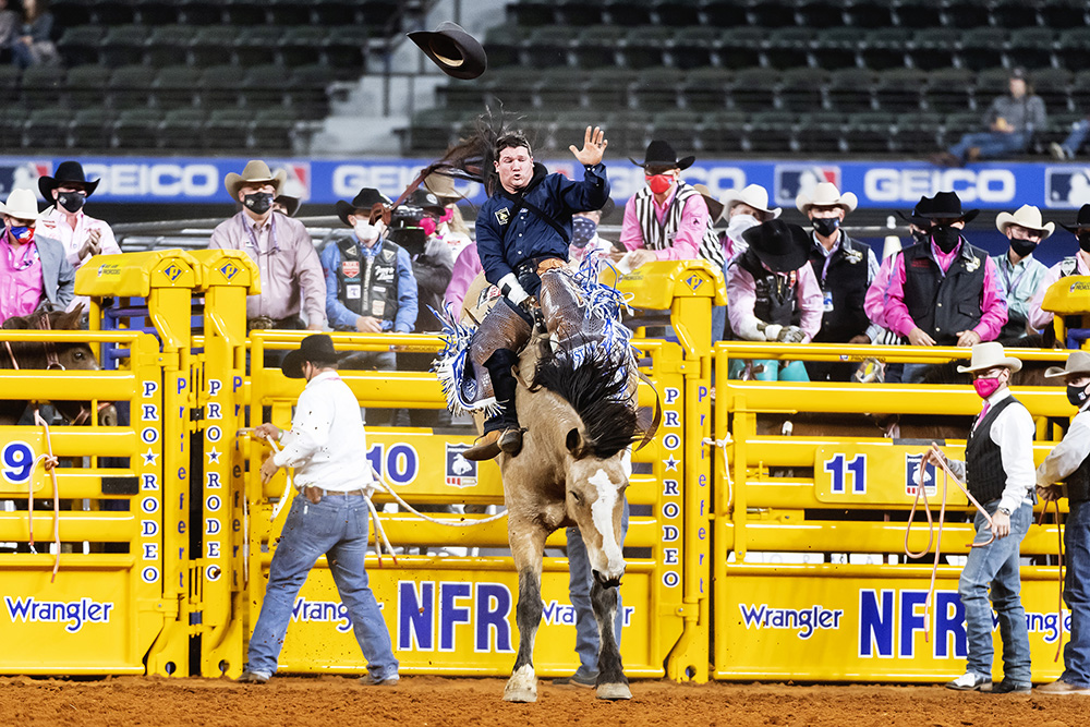 Chad Rutherford rides Frontier Rodeo's Gun Fire for 88 points to finish second in Monday's fifth round of the National Finals Rodeo. (PHOTO BY JAMES PHIFER)