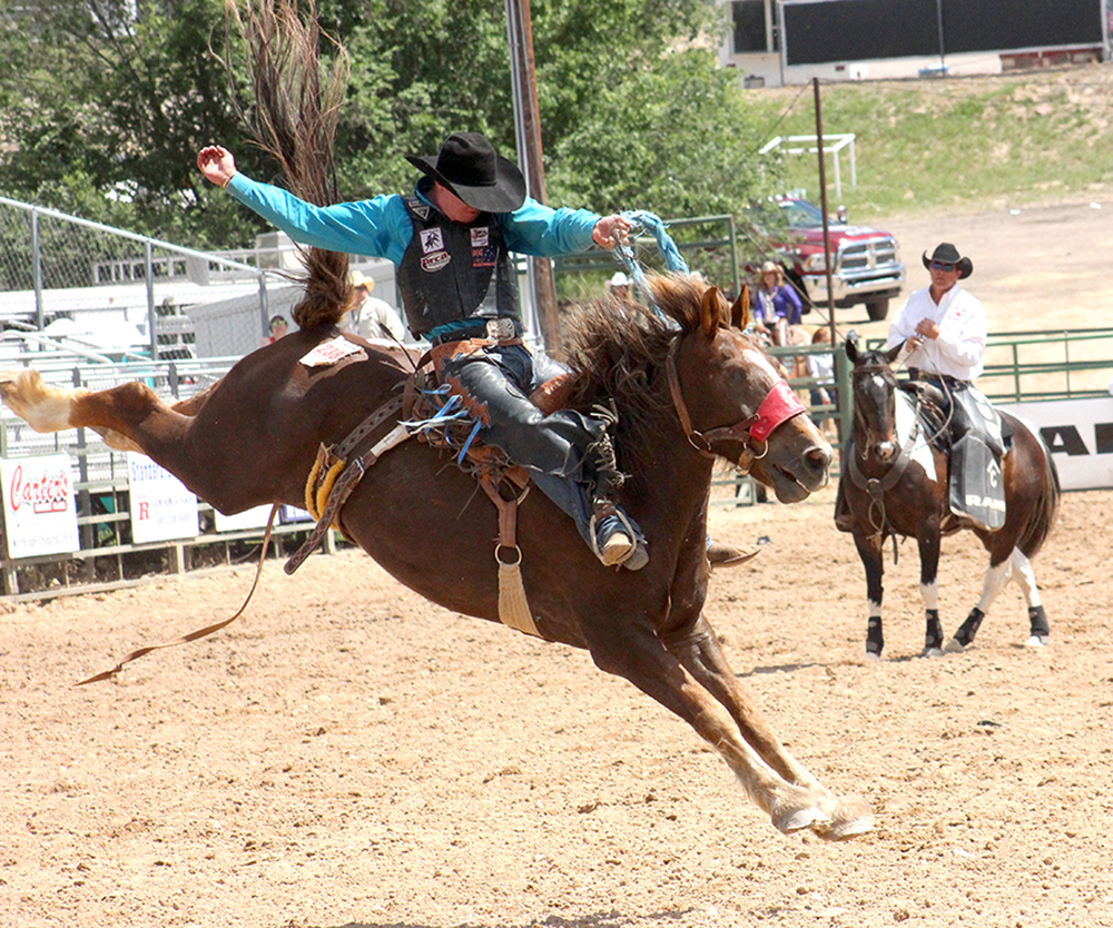 Jake Finlay, the 2018 college national champion saddle bronc rider from Oklahoma Panhandle State, competes at the 2016 Guymon Pioneer Days Rodeo during his rookie season in ProRodeo.